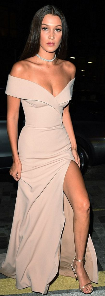 Who made  Bella Hadid's tan off the shoulder town and sandals?Dress – Hugo Boss