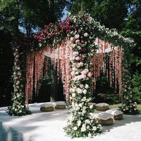 A luxurious mandap setting done in lush greens, roses, and cascading petal & crystal stringed curtain, this is straight out of dreams! decoration pink 27 Latest Floral Mandap Designs for an Enchanting Wedding Decor Desi Wedding Decor, Wedding Hall Decorations, Wedding Mandap, Punjabi Wedding Decor, Wedding Gazebo, Hindu Wedding Ceremony, Mehndi Ceremony, Sikh Wedding, Outdoor Ceremony