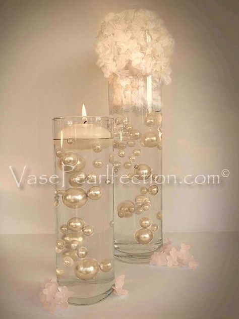 No Hole for smoother appearance...Elegant Jumbo & Assorted Sizes All Ivory/Champagne Pearls Vase Fillers for Centerpieces and Tablescapes  The Pearls DO NOT FLOAT IN WATER ALONE, to float the Pearls you will need our Extra Clear Transparent Water Gels (sold separately on our site under Transparent
