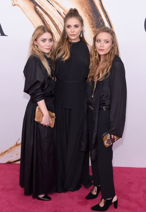 Mary-Kate & Ashley Olsen Are Joined By Sister Elizabeth at CFDA Fashion Awards Photo Mary-Kate and Ashley Olsen are joined on the red carpet by their younger sister Elizabeth Olsen at the 2016 CFDA Fashion Awards held at the Hammerstein Ballroom…