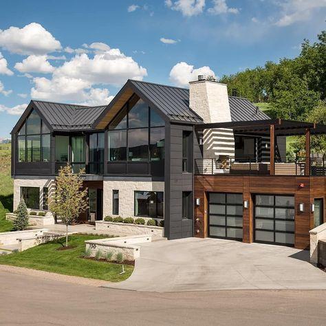 House exterior. Black, medium wood, gray