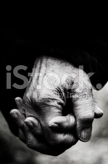 Old hands holding together, Monochrome Shot royalty-free stock photo