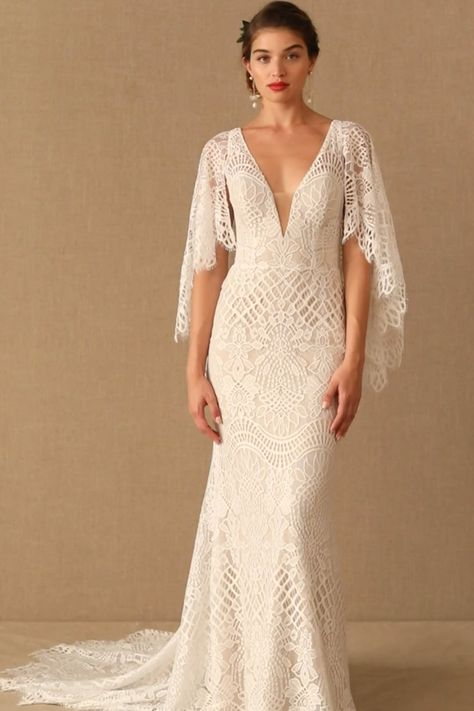 Made from intricate graphic lace, this fitted gown features a plunging v-neckline and dramatic train. The cascading flutter sleeves transform into a gorgeous cape… Wedding Dresses Plus Size, Princess Wedding Dresses, New Wedding Dresses, Wedding Attire, Bridal Dresses, Wedding Dress Over 40, Inexpensive Bridesmaid Dresses, Long Sleeve Wedding, Bridal Outfits