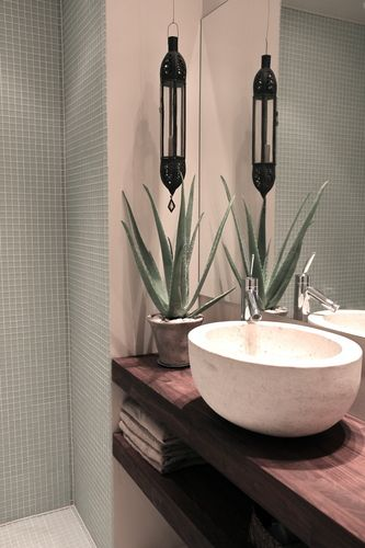 Designed by Gro Saevik. like the two open shelves under vessel sink, plus the diminutive monochromatic mosaic tile on the bath walls.