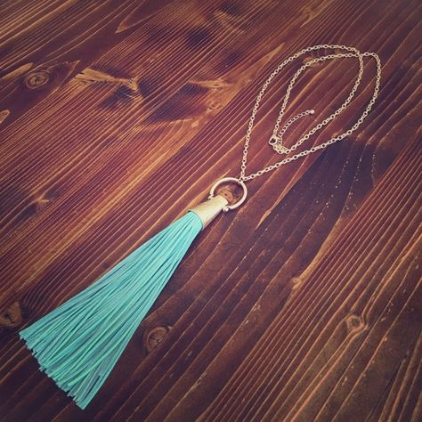 Long Gold and Turquoise Real Leather Tassle Brand new and love this necklace. The real leather tassle shows great movement and looks very high quality because it is. Have other colors available royal blue, tan, orange is sold, beige. This price is for one tassle necklace only!!! Sorry no trades!!! Saya Jewelry Necklaces