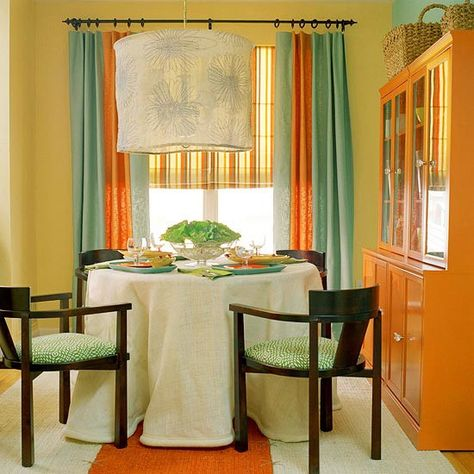 I am thinking maybe this wall color and similar blinds and curtains. Maybe even paint my buffet an amber-orange.