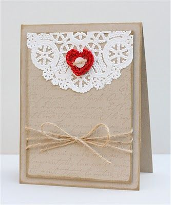 Love the simplicity! Kraft, twine, doily and a sweet red heart with button.