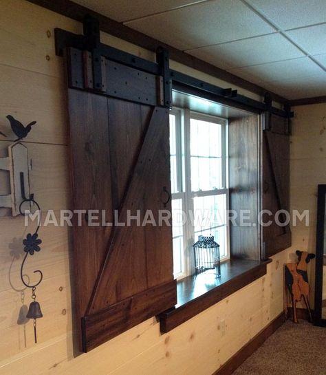 A unique setup for sliding shutters in a renovated basement. Custom built shutters by the Contractor utilizing two 5′ Flat Track Rolling Barn Door Hardware Kit from Agave Ironworks.