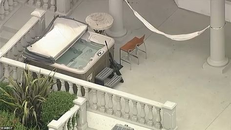 Footage showed what appeared to be a high-powered rifle resting against the star's hot tub...
