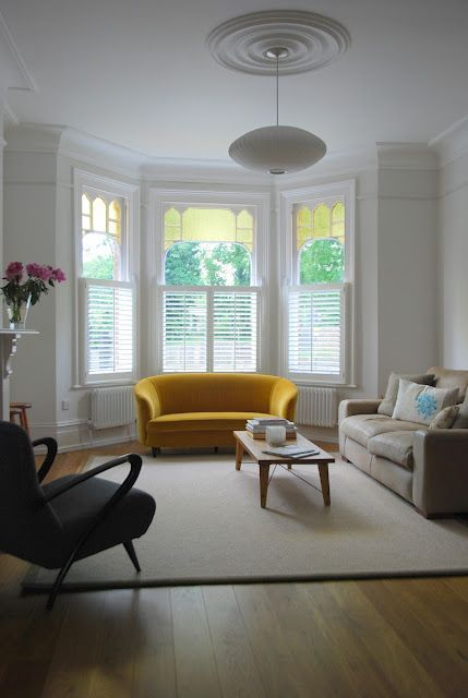 Today S Bay Window Are Anything But Traditional If You Re Thinking About Adding Them To Your Bay Window Living Room Living Room Windows Victorian Living Room