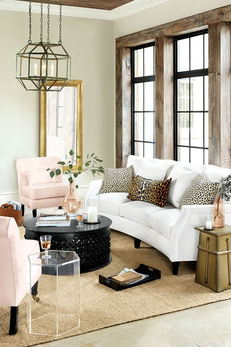 Living room with brass accents, bold lighting, animal print, and blush pink