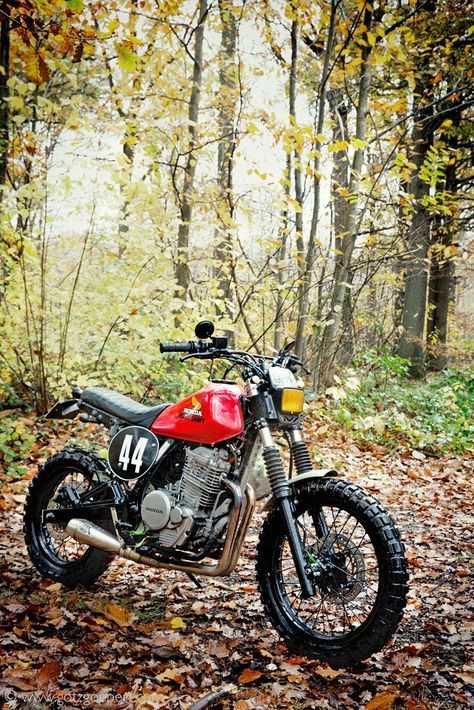 Most folks customize their Honda Dominators with a flat track look. This one has a rough-and-ready scrambler vibe, and we dig it.