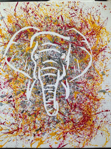 Elephant relief splatter painting. Outline of elephant cut out of contact paper and pasted on canvas. Painted over outline in white to avoid bleeding into the relief later. Splatter with paint, let dry, then peel off the contact paper outline. Voila!