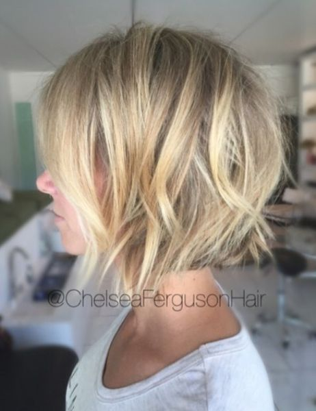 Textured Blonde Bob With Choppy Layers Blowing Fine Hair