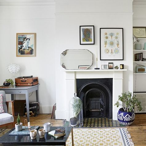 Create eclectic living room style with mismatched frames, unqiue items of furntiure and a collection of old and new accessories