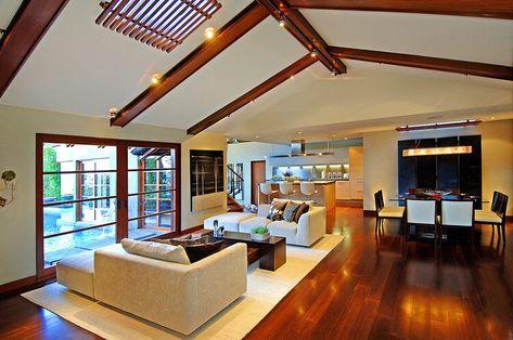 Warm wooden floors & wood beam ceiling in Hollywood Hills home. #luxuryhomes #modernarchitecture #modernhomes #moderndesign #resortstyleliving #luxurydesign #hotelstyle #resortstyle #livingrooms #openplanhome #openfloorplan #interiordesign #highceilings #woodaccents #picturewindow #woodfloors #woodenfloors #woodbeams #modernlighting #hollywoodhills #hollywoodhillshomes #modernfurniture