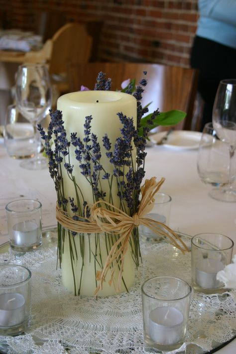simple table centre idea wrapping dried lavender around a large church candle by Lindsey Kitchin of The White Horse Flower Company www.whfco.co.uk