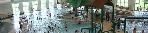 Westerville Rec Center Watering Hole twisty slides, whirlpool for kids and child friendly playground in the water. Rock climbing wall and indoor tree house play area.