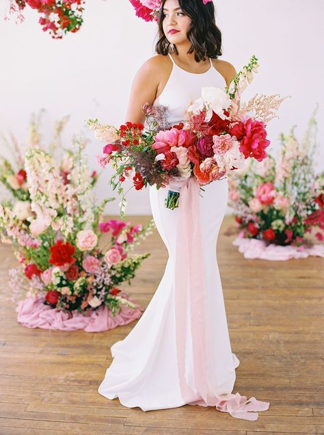 Nothing we love more than colorful wedding ideas! And this microwedding inspiration with layers upon layers of pink is a color lovers dream. With cloud-like floral installations and velvet table linens, botanical headpieces and sexy bridal fashion, these intimate wedding ideas will have you smiling from ear to ear in no time. See the full inspo on Ruffled now! #microweddingideas #fuchsiawedding #floralinstallations