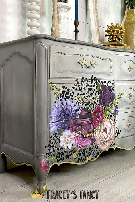 You know how I love a touch of #leopard (well, in this case Cheetah)  I used two different image transfers on this painted dresser makeover. Click over to the blog to get all the details! Whimsical Painted furniture by Tracey Bellion #TraceysFancy How to Paint Furniture Painted Furniture Ideas Gray Painted Furniture Gray Bedroom Dresser Transfers on Furniture Dixie Belle Gravel Road Driftwood Chalk Paint Color Ideas Cheetah Transfer Redesign Lush Floral II Milk Paint DIY Furniture Makeover