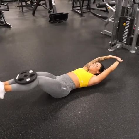 An AB-solutely perfect workout for your ab day! Try these weighted knee crunches into leg extensions - keep lowering back against the floor to get the most out of your workout! #Gymshark #Workout #Target #Fitness #Gym #Exercise #Sweat #Challenge #Core #Abs