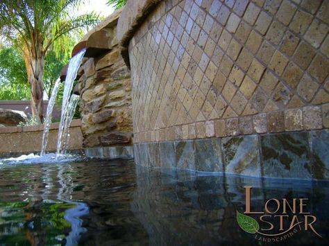 Travertine tile on pool water feature and copper scuppers on ...
