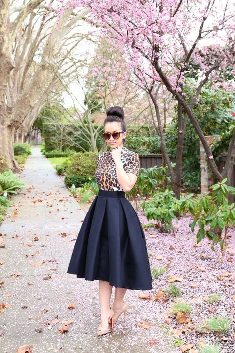 Classic, chic, elegance with the high low skirt, leopard print, and a bun - Sooo pretty
