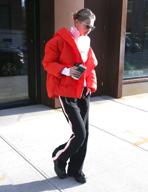 Gigi Hadid spotted in a H M red puffer jacket for the winter.  b3e5516dbe