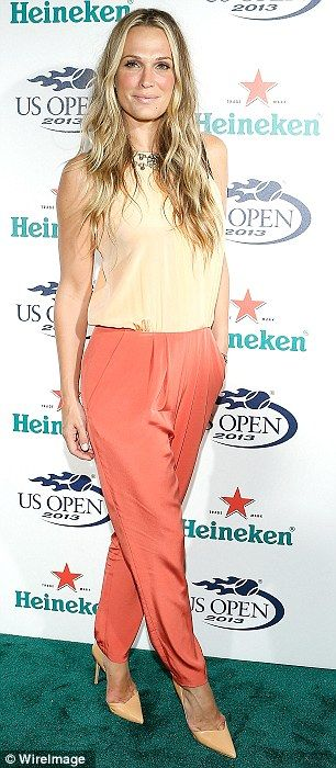 Fan favourite: Molly Simms and Rosario Dawson arrived at a pre-party for the US Open in New York on Thursday night wearing rival orange outfits