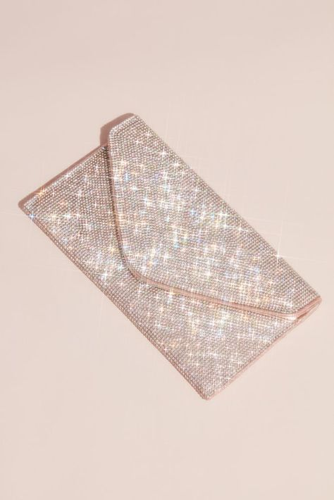 Slip your essentials into this blingy envelope clutch, encrusted with rows and rows of tiny crystals. Synthetic Hidden chain strap Magnetic snap closure 5 H, 9 W, 3 D Imported Rose Gold Clutch Bag, Prom Clutch Bags, Silver Clutch, Bridal Clutch, Wedding Clutch, Wedding Bag, Clutch Purse, Sparkly Clutches, Formal Clutches