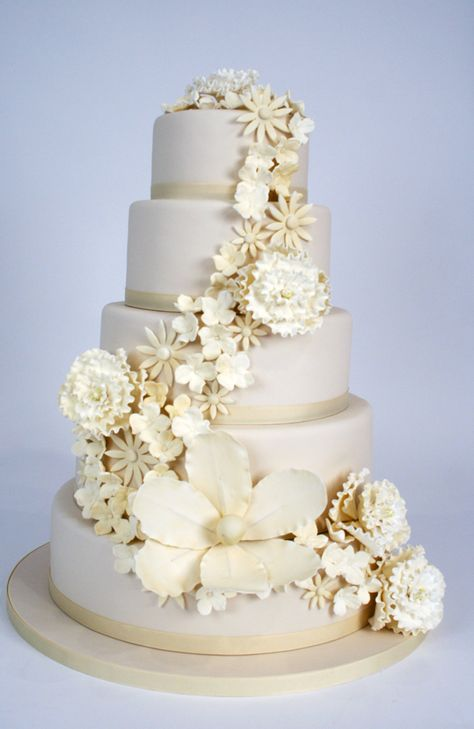 Ivory cake by Charm City Cakes with cascade of ivory gumpaste florals