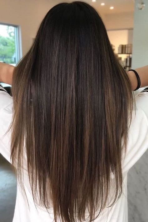 Brunette balayage ; straight hair ; brown highlights ; long