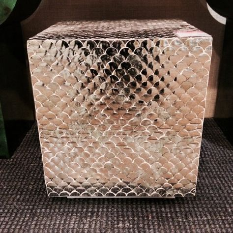 Tikra mirror from India covers this versatile (yet super-glam) piece in a fish scale pattern. Shiny, natural, textural and useful as either a side table or stool. Organic glitz! From Made Goods, Interhall