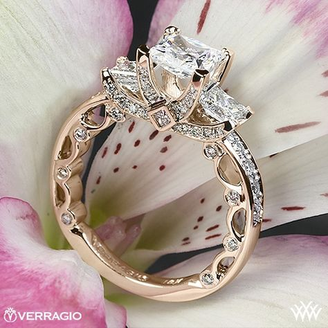 This beautiful 3 Stone Engagement Ring is from the Verragio Paradiso Collection. It features a Lumino Set for both the center and side diamonds and holds 1.00ctw of both Round Brilliant & Princess Diamond Melee (F/G VS). The width tapers from 3.1mm at the top down to 2.2mm at the bottom. Select your diamond from our extensive online diamond inventory. Please allow 4 weeks for completion. Platinum rings carry a 5 week turnaround time. If you have any questions regarding this item then please c...