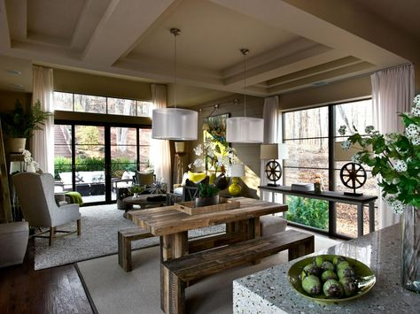 This nature-inspired living room is connected to a lovely courtyard by a wall of glass framed by custom-made drapes. Colors, textures and even the height of furniture was kept down in order to highlight the view outside.