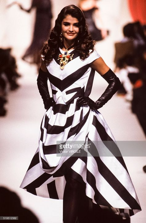 Helena Christensen walks the runway at the Chanel Haute Couture Spring/Summer fashion show during the Paris Fashion Week in January, 1990 in Paris, France. Get premium, high resolution news photos at Getty Images