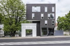 Grey Brick And White Windows Brick Apartments Grey Brick Apartment Building