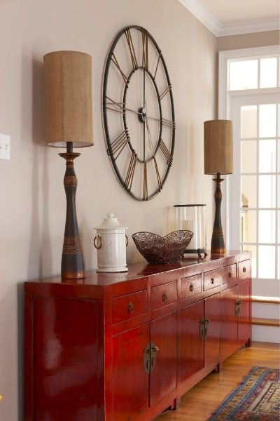 Clock over entrance table. - Why did they have to make the 4 a IIII instead of IV?? I'm not sure I could ever own this clock now!