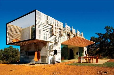 Unusual Homes: Shipping Container Homes: Infiniski, a design, architecture and construction firm with offices in Madrid and Chile, artfully combines used train rails; recycled aluminum, iron and wood; and repurposed pallets to create mod structures with a hip sensibility.