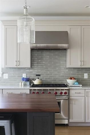 Example Of A Classic Gray Light Green And White Kitchen Design