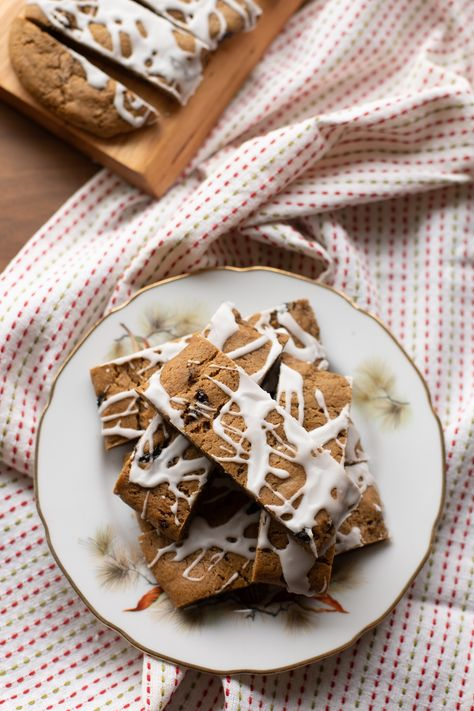 These old-fashioned bar cookies have a sweet molasses-and-spice dough that's generously dotted with raisins and drizzled with a snowy white vanilla icing. They're a classic for a reason!