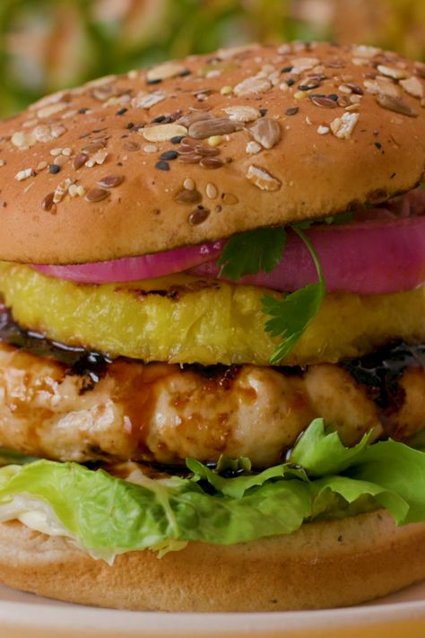 Transport your taste buds to paradise with a pineapple chicken teriyaki burger, perfected with Dave's Killer Bread 21 Whole Grains and Seeds Buns. #ad