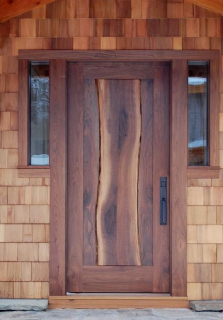 The live edge of the center stave of this walnut door lends an organic feel along with contrasting color tones. D27