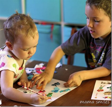 Kids can work together to build a story scene with stickers - such a simple and educational play idea!