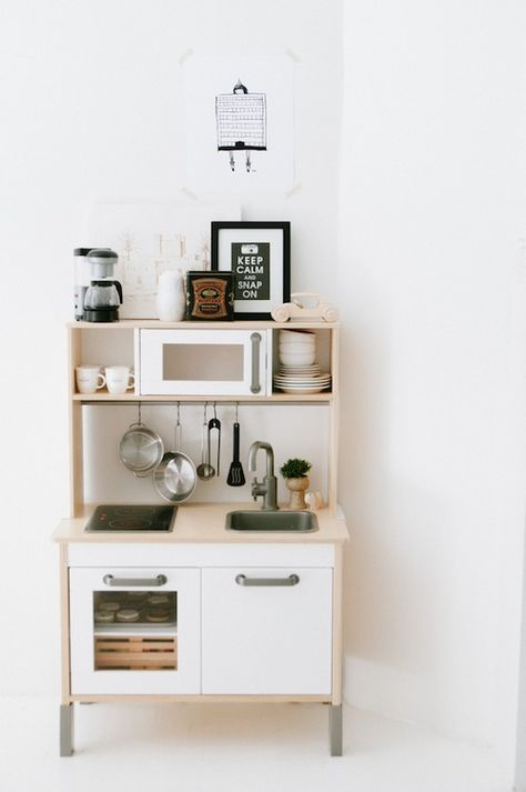 Living With Kids: Tina Fussell - we have this Ikea kitchen...but obviously not such organised little chefs :-)