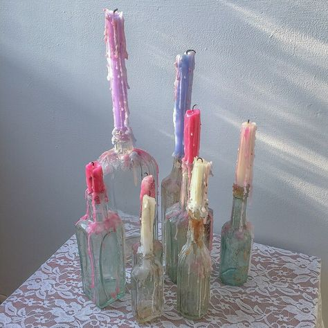 pretty candles on bottles