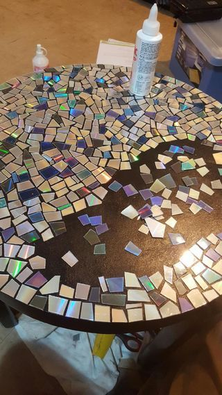 CD Mosaic Table is part of Cd diy CD Mosaic Table We were going to throw out a bunch of old CD& when I remembered we had this coffee table sitting on the back porch gathering dust Very happy wit - Cd Mosaic, Mosaic Crafts, Mosaic Projects, Diy Projects, Mosaic Mirrors, Mosaic Birdbath, Old Cd Crafts, Home Crafts, Diy Home Decor