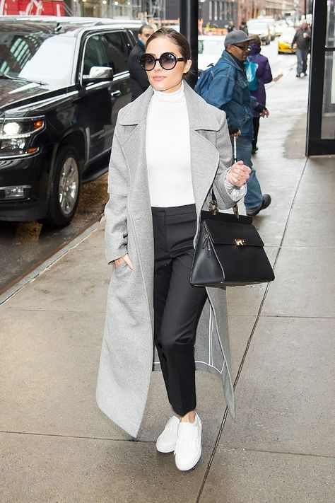 Olivia Culpo wearing Wolford Colorado Bodysuit in White, Tod's Fringe Slip-on Sneakers and Balenciaga Le Dix Zip Cartable Bag