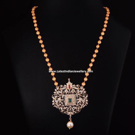 Necklaces Simple Pearl Drop Diamond Mala - Traditional diamond pendant design adorned with emerald in the center and a single pearl drop is attached to simple gold balls chain for an elegant look.