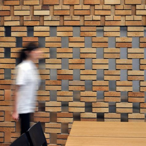 Brick Screen Cornerstone Restaurant in Beijing CBD, China by Studio Ramoprimo